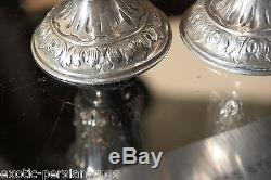 A Pair of 800 silver Antique Karl Sohnlein & Sohne Putti casters salt and pepper