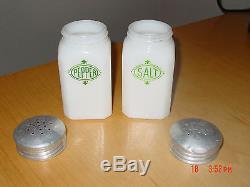 Milk glass salt and pepper shakers original lids