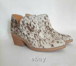 Western style cowgirl hair on Salt and Pepper cow hide leather boots pointed toe